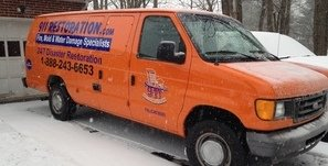 Water Damage Restoration Van At Winter Residential Job Site