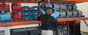 Water Damage Restoratio Festus Technician Mobilizing Air Movers